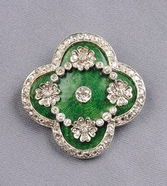 Enamel and Diamond Brooch, set with transitional-, rose-, and single-cut diamond melee, green guilloche enamel background, millegrain details, 14kt gold silver topped mount, lg. 1 1/2 in.