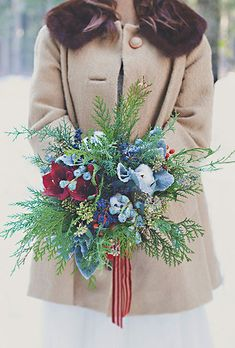 Winter Wedding Bouquet with Cedar Sprigs, Red Peonies, and Blue Flowers Winter Wedding Bouquets