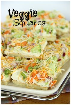 Veggie Squares _ They are always a hit! Crescent rolls, ranch packet, cream cheese, mayo, veggies, & shredded cheese…super easy!