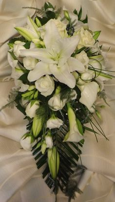 white oriental lilys, calla and roses in a classic shower bouquet  www.weddingflowersbylaura.com
