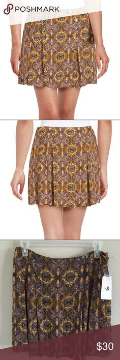 NWT Free People Lovers Lane Print Skirt Size 6 New with tag. Free people skirt size 6. 100% rayon. Has a little zipper on the side and a green skirt under the print skirt. Free People Skirts Mini