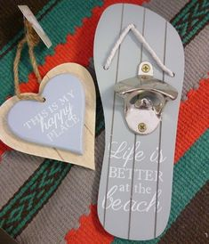 Wall mounted blue wooden flip flop with strong silver metal bottle opener and Life is BETTER at th beach writen in white rope detail to front and