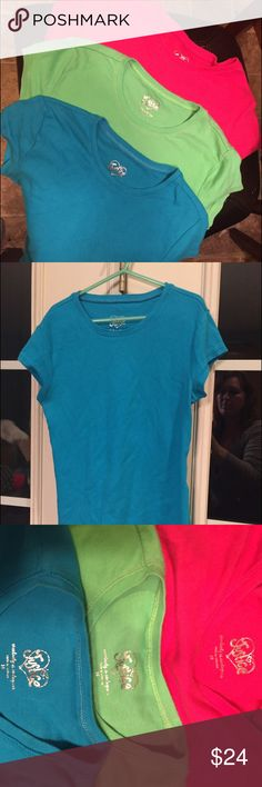 Justice standard girls t-shirts Pink blue & green Three t-shirts in size 10 girls. Justice for girls brand in bright pink, bright blue, and green. These are perfect for layering or wearing alone. They are a long t-shirt so there's no tummy showing with raising a hand in class lol really nice quality and in great condition you get all 3 Justice Shirts & Tops Tees - Short Sleeve