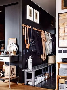"""An Unexpected (& Seemingly Counterintuitive) Foyer Trick to Make Your Home Feel Bigger Entryway inspo: the dark color wall makes the """"true"""" bright interior pop – the coats etc blen Home Design Decor, Home Interior Design, Interior And Exterior, House Design, Modern Interior, Decorating Ideas For The Home Bedroom, Foyer Decorating, Interior Decorating, Decoration Hall"""