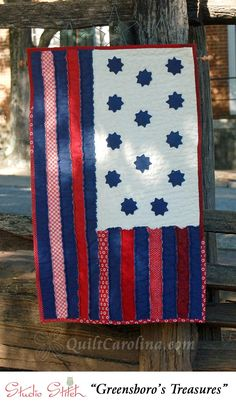 """""""Greensboro's Treasures"""" – this wonderful recreation of the Revolutionary War Flag used at the Greensboro Battlefield, a sure hit for history lovers, is made using denim with exposed seams for a raw edge look! A 2017 Quilt! Carolina pattern."""