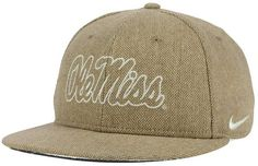 Show your college team pride with the style of the Mississippi Rebels True Tweed Snapback cap. A raised team logo is embroidered at front, and a Nike swoosh at the left side complements the team colors while telling the world you don't settle for less than the best. High crown Structured fit Normal bill Raised embroidered team logo at front Nike swoosh logo at left side Snapback closure Polyester/acrylic/viscose/nylon Spot clean only