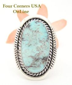 Large stone Dry Creek Turquoise Concho style Sterling Silver Ring Size 8 by seasoned Navajo Artisan Eugene Belone Authentic Native American Indian Jewelry. Large oval shape Dry Creek Turquoise stone offers a superberb blend of soft blue coloring complimented by a dark cocoa matrix.