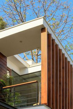 Wooden slats offer shade and privacy to the balcony