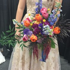 A gathered look in our skittles bouquet! The colors look beautiful together! #rbdbride #gardenweddingflowers #southernwedding #realworldfloraldesign