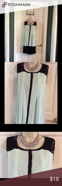 MINT GREEN COLOR BLOCK TOP Lovely top has black color blocking down front and at top. This is a nice flowing material just perfect for the warm months. Sleeveless, lace at top, very pretty. Elle Tops Blouses