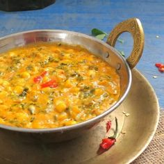 Corn and fresh fenugreek cooked in a mild and rich curry.