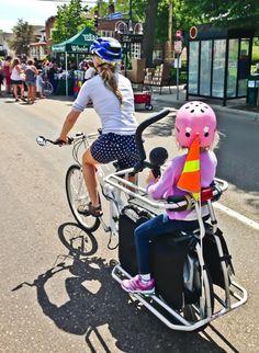 These moms take biking with kids to a next level. Check out their rad bike setups. Surly Big Dummy, Urban Arrow, Xtracycle Edgerunners, and more are in the kid-bike-mom feature. Child Bike Seat, Cool Bike Helmets, Tandem Bicycle, Baby Bikini, Bike Trailer, Cargo Bike, Kids Seating, Bike Style, Kids Bike