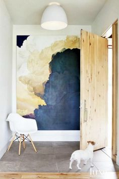 large abstract art makes a grand statement in this entryway