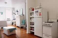 Articles about collection/small spaces on Apartment Therapy, a lifestyle and interior design community with tips and expert advice on creating happy, healthy homes for everyone. My First Apartment, Dream Apartment, Apartment Living, Apartment Therapy, White Apartment, Apartment Kitchen, Tiny Apartments, Tiny Spaces, Small Space Living
