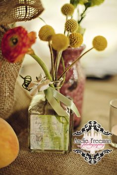 Peach themed tablescapes with white hydrangeas, peaches, and coral roses in burlap wrapped vase with brooch. Yellow billyballs in shabby chic vase. Mismatched vintage china on burlap covered table.  Summer shabby chic barn wedding. Photography by Andie Freeman Photography www.TheAthensWeddingPhotographer.com Event design, floral, and planning by Wildflower Event Services www.WildflowerEventServices.com Venue:  Private property in Chickamauga, Ga Barn Wedding Inspiration, Coral Roses, White Hydrangeas, Private Property, Event Services, Vintage China, Bud Vases, Wildflowers, Event Design