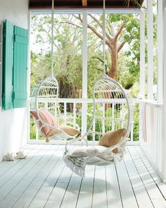 Hanging Rattan Chairs from Serena & Lily. 11 Steps to Resort Decor: How to Bring Vacation Vibes Home When You Can't Get Away #resortdecor #hangingchairs #rattan #tropical