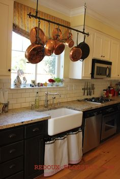 kitchen--and I love the hanging pot rack!