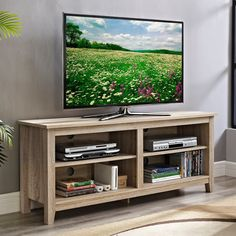 The design creates a rustic, urban look crafted from high-grade MDF and durable laminate. Console accommodates most flat-panel TVs up to 60 in. Features adjustable shelving that  provides ample space for A/V components and other media accessories.