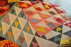 I stopped hating triangles! Another publication! Also, some thoughts on quilt backs.