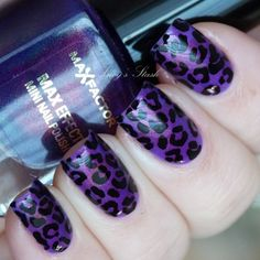 purple nails, silver cheeta print, and one silver sparkle nail... yes.