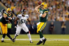 Aaron Rodgers #12 of the Green Bay Packers throws a pass in the first quarter against the Seattle Seahawks during their game at Lambeau Field on September 20, 2015 in Green Bay, Wisconsin. (Sept. 19, 2015 - Source: Christian Petersen/Getty Images North America)