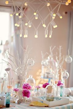 For a white wedding-hanging white light with white, clear bulb centerpieces.