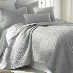 Dove gray bedding is serene and peaceful in a beach house bedroom. | $105