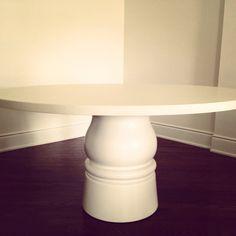 Brooke Butler Design custom dining table - concrete top & turned wooden base. Love