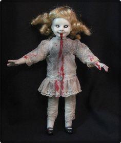 the possessed doll  www.creepy-dolls.com
