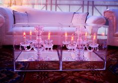 Your friends have : Scoped out which banquet hall has the most chandeliers.     We prefer : Taking traditional ballroom for a whirl with chandeliers in plexiglass boxes.    Image by  Michael Falco .