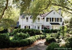 Colonial classic complete with a boxwood lined path