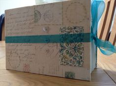Family photo and history album tied with an organza ribbon