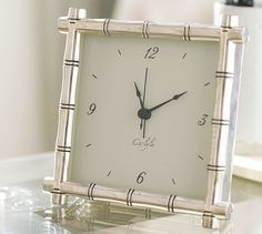 A silver-plated bamboo design naturally frames this artful clock.