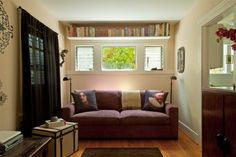 Love the bookshelf above the windows. Perhaps we could do this in our bedroom.