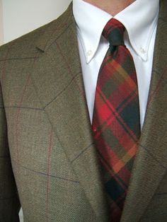 Now that's how you mix Plaid patterns. Maple Leaf Tartan wool tie by MacCleods. Jacket by Brooks Brothers.