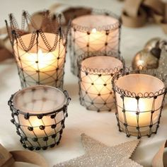 Who has the best candle holders? Find the perfect glass candle holders, candle lanterns, hurricane candle holders and more at Ballard Designs! Holiday Candles, Candle Lanterns, Votive Candles, Reception Decorations, Christmas Decorations, Stylo 3d, Art Fil, Votive Candle Holders, Wire Crafts