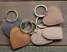 I think these are adorable! Love the simple colors and they could def. be for keychains for anything. I would love to have one for my keys. Leather Keychain, Leather Earrings, Leather Jewelry, Leather Scraps, Leather Projects, Small Leather Goods, Key Fobs, Leather Design, Leather Accessories