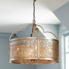 Light up your room in warm global tones with our Marbella Drum Pendant. The gently arced shade is handmade of intricately pierced metal that casts a lacy pattern of light and shadow. Contrasting flat stock arches crown the shade, echoing the scalloped shape. Marbella 4-Light Drum Pendant features:Antique champagne finishRivet detailsHidden seams