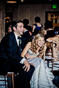 Must-have photo of the bride and groom's reaction to the bridal party speeches | Photo by JAGstudios