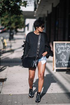 black sweatshirt + black purse + shorts + black booties