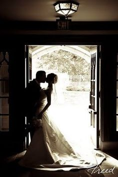Silhouette of bride and groom... this won't be hard to take because this is what the entrance of our church looks like :)