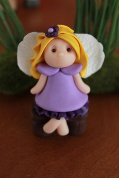 This listing is for one (1) hand sculpted polymer clay fairy. Each fairy is approximately 2 1/2 from head to toe and is in a sitting position - and