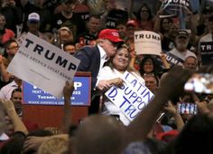 Trump refuses to condemn violence at his rallies