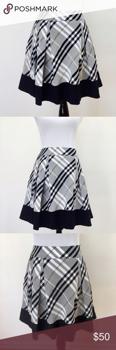 "Burberry plaid skirt High waisted, lined, Burberry blue label,  18 1/2"" in length, 14"" across, would fit a 0-2 (24/25/26), size 38 on the label, I put a small in the size it'll fit someone who can wear a small in bottoms the best Burberry Skirts Midi"
