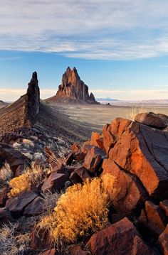 """Shiprock (Navajo: Tsé Bit'a'í, """"rock with wings"""" or """"winged rock"""" is a monadnock rising nearly 1,583 feet (482.5 m) above the high-desert plain on the Navajo Nation in San Juan County, New Mexico, USA. It has a peak elevation of 7,177 feet (2,187.5 m) above sea level."""
