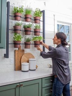 Cody and Katie Messerall's kitchen from Fixer Upper Season 3, episode 16.  Herb garden rack.  Close-up of herb rack and pots.