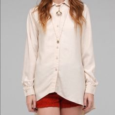 American Gold Beige Joaquin Blouse Like new condition! Beige button up the front blouse with a tapered back, and super cute triangle cutout in the back! American Gold Tops Button Down Shirts