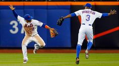 Juan Lagares and Curtis Granderson of the New York Mets