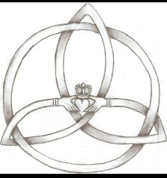 Tattoo I designed. Its a claddagh inside of a trinity knot.