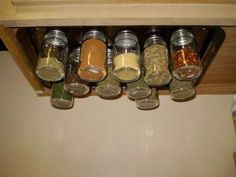Re-Use Idea: Baby Food Jars... also I would do this inside of cabinet